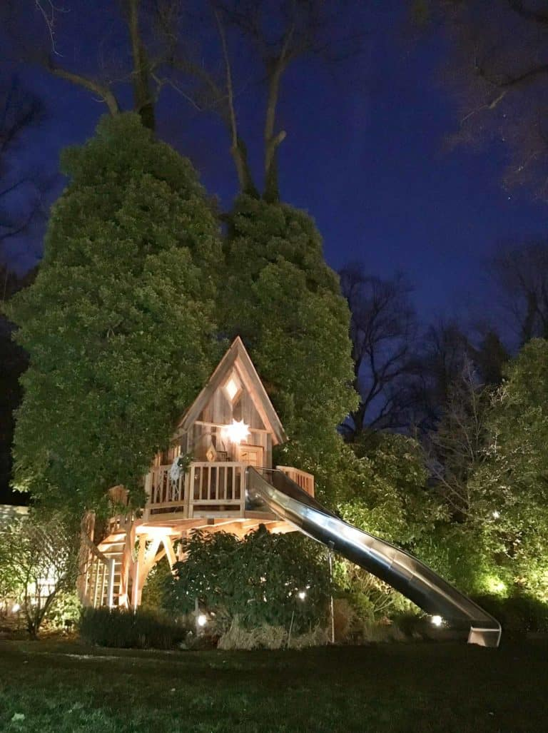 beautiful-treehouse-with-slide-at-night-768x1027